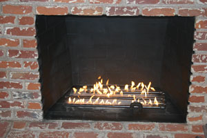 burner and sand brick fireplace