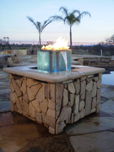 fire pit table with water and fire feature