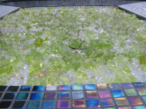 green burning glass fire pit