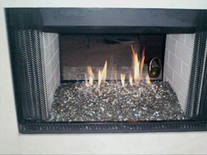 2 way fireplace with fire glass