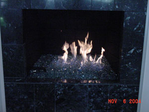 fire in glass fireplace design